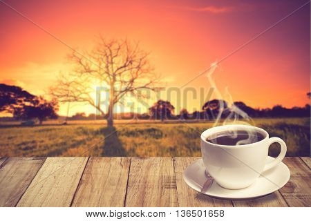 Cup Of Coffee With Mountain At Old Oak In Sunset With Sun.vintage Color