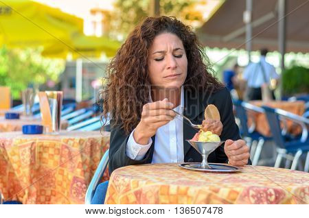 Attractive Woman Savoring An Ice Cream Sundae