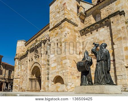 Zamora Spain - June 20 2016: Principal facade of Church of San Juan Bautista in mayor square of Zamora with a Merlu easter statue. Castilla y Leon Spain.