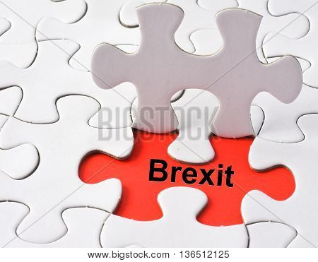 Brexit on missing puzzle concept on red background