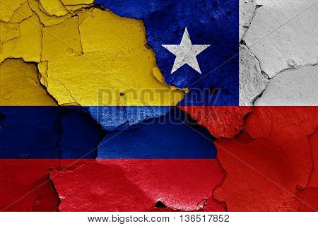 Flags Of Colombia And Chile Painted On Cracked Wall