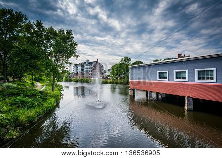 Buildings Along The Cocheco River And Fountain In Downtown Dover, New Hampshire.