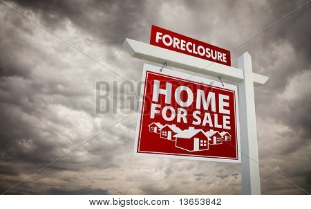 Red Foreclosure Home For Sale Real Estate Sign Over Ominous Cloudy Sky.