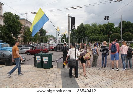 Kiev Ukraine - May 28 2016: Man holding a flag of Ukraine overturned the contrary during the City Day celebrations