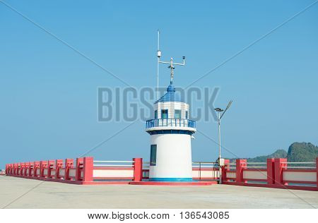 Lighthouse jutting out into the sea , thailand