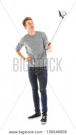 Young handsome man taking selfie isolated on white