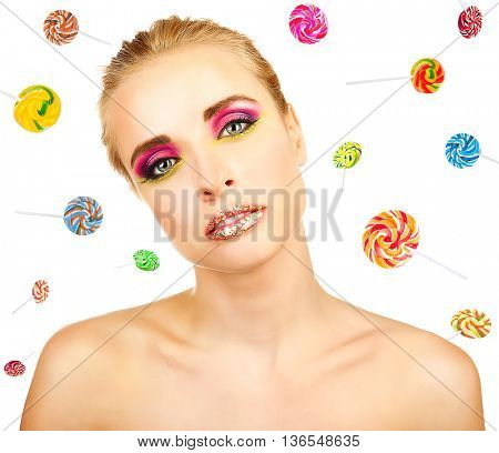 Beautiful girl with colorful lollipops on white background