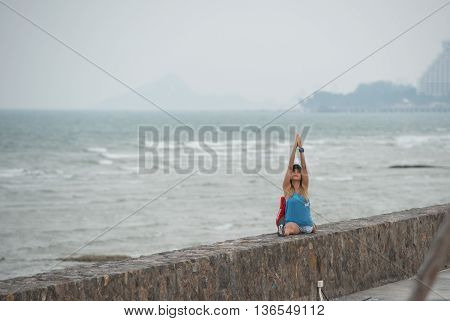 HUAHIN THAILAND-APR13:Unidentified people playing yoga side the sea at prachuapkirikan thailand on 13 april 2016