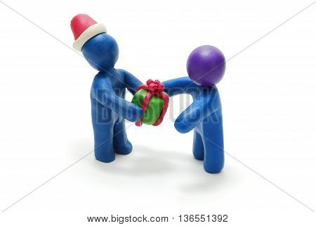 3D Plasticine Man as Santa Claus Giving Christmas Gift to Another Person Isolated on White Backgrou