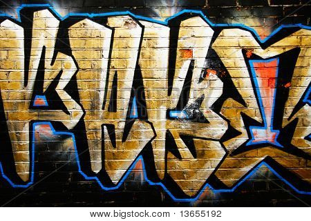 A smart graffiti tag on a brick wall