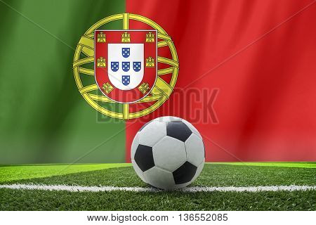 soccer ball in front of the Portugal flag