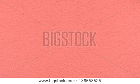poly-foam the painted in pink color, uneven surface, small drawing a circle, glints in the sun