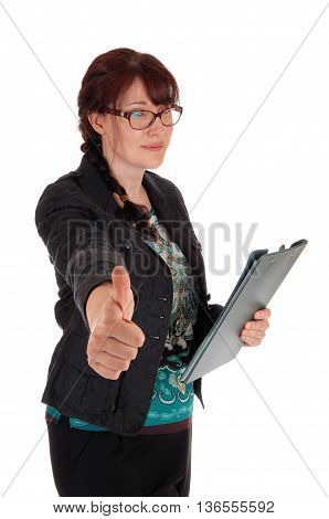 A Caucasian business woman standing with her clipboard in her hand and showing her thump up isolate for white background.