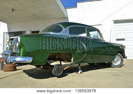 HILLSBORO, NORTH DAKOTA, June 15, 2016: The restored 1950's Chevy car on jacks is a product of  the Chevrolet Division of General Motors Company, an American automobile division of the American manufacturer General Motors