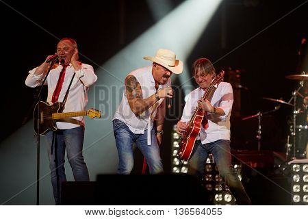 MOSCOW, RUSSIA - APR 24, 2015: Musicians of Secret band N.Fomenko, M.Leonidov and A.Zabludovskii in concert during show on Crocus city hall. Rock and roll band Secret founded in 1982 in Leningrad