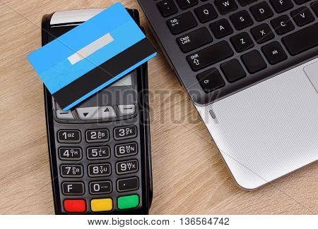 Payment Terminal With Contactless Credit Card And Laptop, Finance Concept