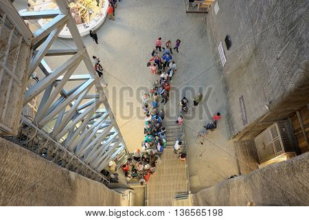 TURDA, ROMANIA - AUGUST 10, 2015: many people in line to take the elevator of Salina Turda a salt mine turned into a underground tourist attraction