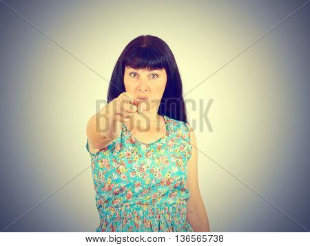 Young Woman Accusing Someone  Pointing With Finger