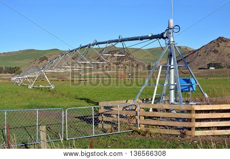 A pivot Irrigation Machine on a farm in North Canterbury New Zealand ensures that fields are green and productive all year round.