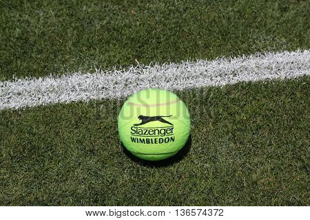 NEW YORK - JUNE 30, 2016: Slazenger Wimbledon Tennis Ball on grass tennis court. Slazenger Wimbledon Tennis Ball exclusively used and endorsed by The Championships, Wimbledon