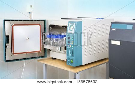 Modern laboratory autoclave sterilizer on the table poster
