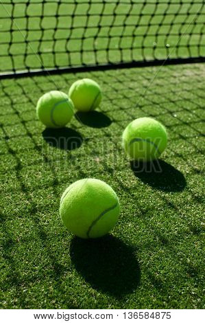 Selective Focus. Tennis Ball Back Light Shadow On Tennis Grass Court Good For Background