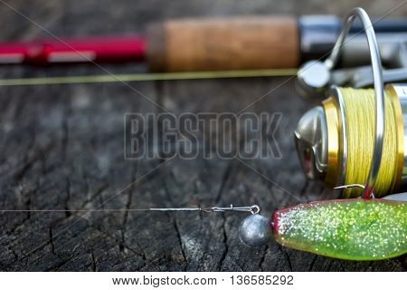 Fishing Lure, Rod And Reel On Wood