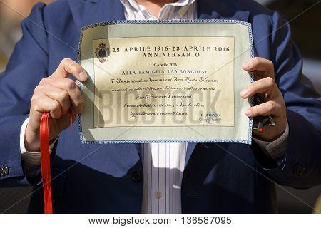 Sant'Agata Bolognese, Italy - April 30, 2016: commemorative parchment donated to Tonino Lamborghini by the mayor of S.Agata Bolognese during the parade for the 100th anniversary Ferruccio Lamborghini