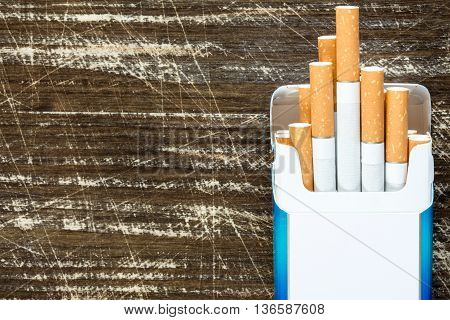 Open pack of cigarettes with cigarettes sticking out.