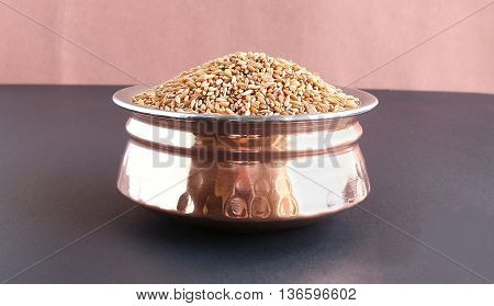 Bamboo rice, which is said to be an alternative medicine for health issues like cough and asthma, in a copper bowl.