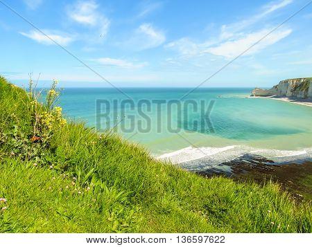 Seacoast and famous cliff La Falaise d'Amont as background. Etretat, Normandy, France. Selective focus