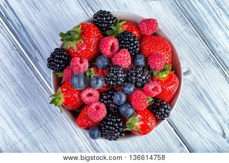 Bowl Of Fresh Fruit. Bblackberries; Raspberries; Blueberries On A Bowl.