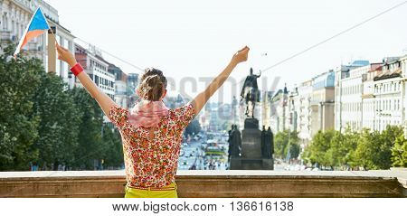 Seen From Behind Young Woman With Czech Flag Rejoicing In Prague