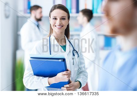 Confident Female Doctor Holding Medical Records