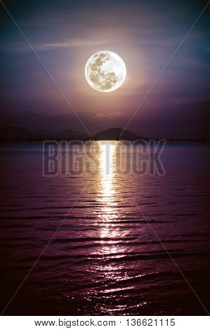 Romantic Scenic With Full Moon On Sea To Night. Reflection Of Moon In Water.