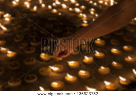People Light Candle To Pay Respect To Buddha Relic - Blur Image