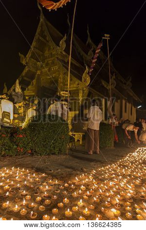 Candle Light To Pay Respect To Buddha Relic At Buddhist Temple