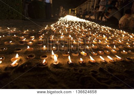 Candle Light To Pay Respect To Buddha Relic