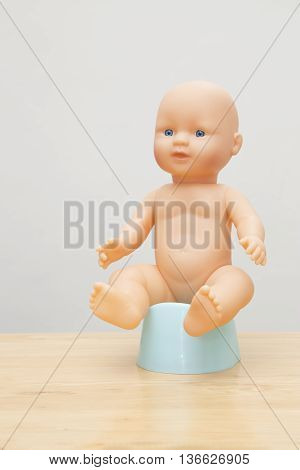 Doll Sitting On Potty, Potty Training Concept