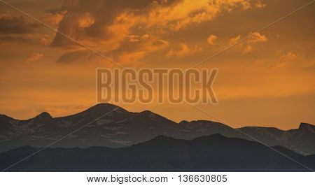 silhouette of Front Range of Rocky Mountains against sunset sky, Longmont, Colorado