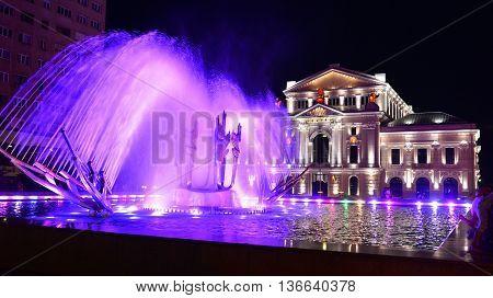 DROBETA TURNU SEVERIN ROMANIA - 06.21.2016: city theater and water fountain landmark architecture