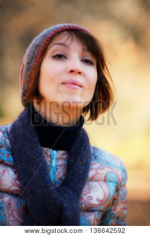 portrait of a pretty woman in the autumn park the age of forty-five years
