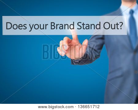 Does Your Brand Stand Out? -  Businessman Press On Digital Screen.