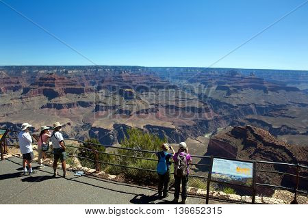 GRAND CANYON ARIZONA USA - JUNE 14 2016: Tourist stand and view at the south rim of Grand Canyon National Park in Arizona USA.