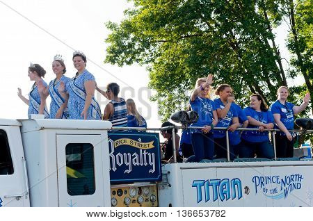 SOUTH ST. PAUL, MINNESOTA - JUNE 24, 2016: Rice Street Festival Royalty waves to crowd during annual South St. Paul Kaposia Days Grande Parade on June 24.