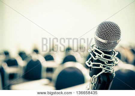 A chained microphone - Freedom of the press is oppressed. poster