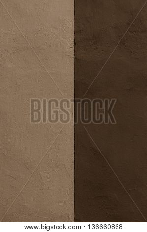 Half colored texture plaster wall exterior dark biege and brown