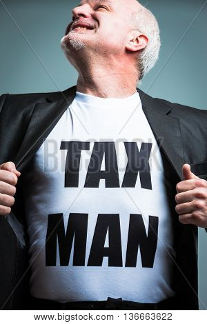 Man Opening Shirt With Tax Man Text