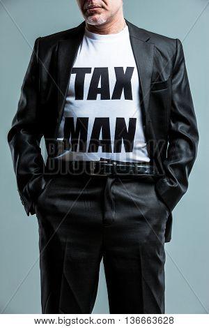 Stern Man Wearing A Tax Man T-shirt