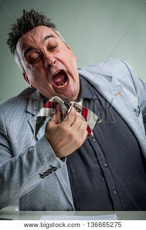 Businessman Sneezing On His Necktie